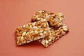 Three stacked bars of nut brittle