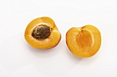 Apricot, halved (overhead view)