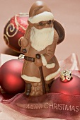 Chocolate Father Christmas, red Christmas bauble