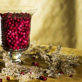 Cranberries in Hurricane Vase as Christmas Decoration