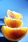 Three wedges of blood orange