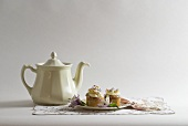 Plate of Cupcakes with Tea Pot