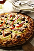 Sausage and Vegetable Pizza on Wooden Wheel