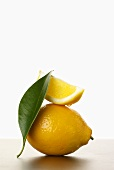 Lemon Slice on Whole Lemon with Leaf