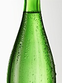 Green glass bottle with condensation (detail)