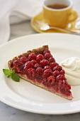Slice of Raspberry Tart on White Plate