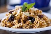 Fusilli Pasta with Tomato Kalamata Olive Sauce; Parsley Garnish