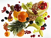 Various types of fruit against white background