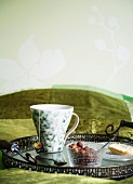 Breakfast tray on a bed with a green bedspread