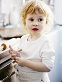 Little girl baking biscuits