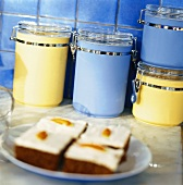 Pieces of cake and coloured storage jars