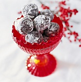 Chocolates in red pedestal bowl