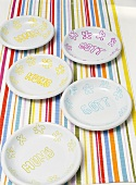 Plates with inscriptions on striped tablecloth