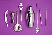 Bar utensils against purple background