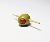 Green olive stuffed with red pepper