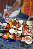 Prawn and vegetable kebabs ready for barbecuing