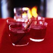 Warm cranberry drinks with cinnamon sticks