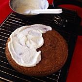 Spreading chocolate sponge with coconut cream