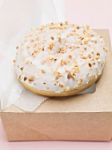 Iced doughnut with chopped nuts