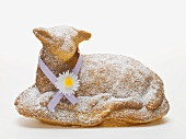 Baked Easter lamb with icing sugar and ribbon