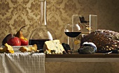 Still life with pheasant, cheese and wine