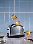 Toaster, coffee, orange juice and newspaper