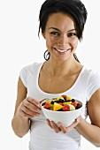 Woman holding fruit salad