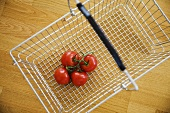 Tomatoes in shopping basket (overhead view)