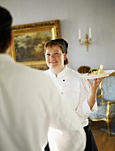 Female chef serving food in Swedish castle
