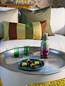 Sweets and drinks on occasional table in front of sofa