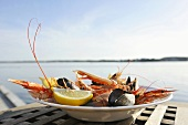 Plate of seafood on plate by sea