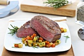 Beef fillet steak with diced vegetables and rosemary