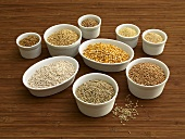 Various types of cereal grains in small bowls