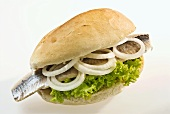Matjes herring roll with lettuce and onions