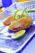Deep-fried crabmeat with coconut coating, lime slices