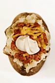 Baked Potato Topped with Chili, Cheese and Sour Cream