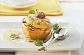 Baked apple with almonds and raisins