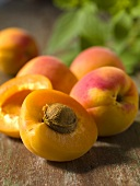 Fresh apricots, one halved