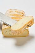 Cow's milk cheese with cheese knife