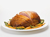 Glazed roast ham with carrots and asparagus