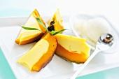Pumpkin mousse in pumpkin with vanilla ice cream