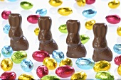 Chocolate bunnies and small chocolate eggs in coloured foil