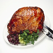 Apricot Glazed Ham on Platter with Carving Utensils