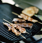 Satay on a barbecue