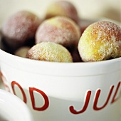 Sugared apples in ceramic bowl (Christmas)