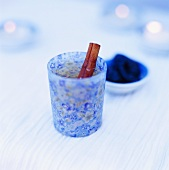 Tea with cinnamon stick in blue glass