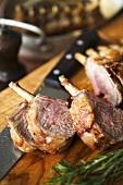Roast rack of lamb on chopping board