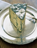 Piece of blue cheese on silver plate