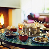 Coffee and snacks on table in front of fire