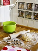 Biscuit dough and cutters in kitchen